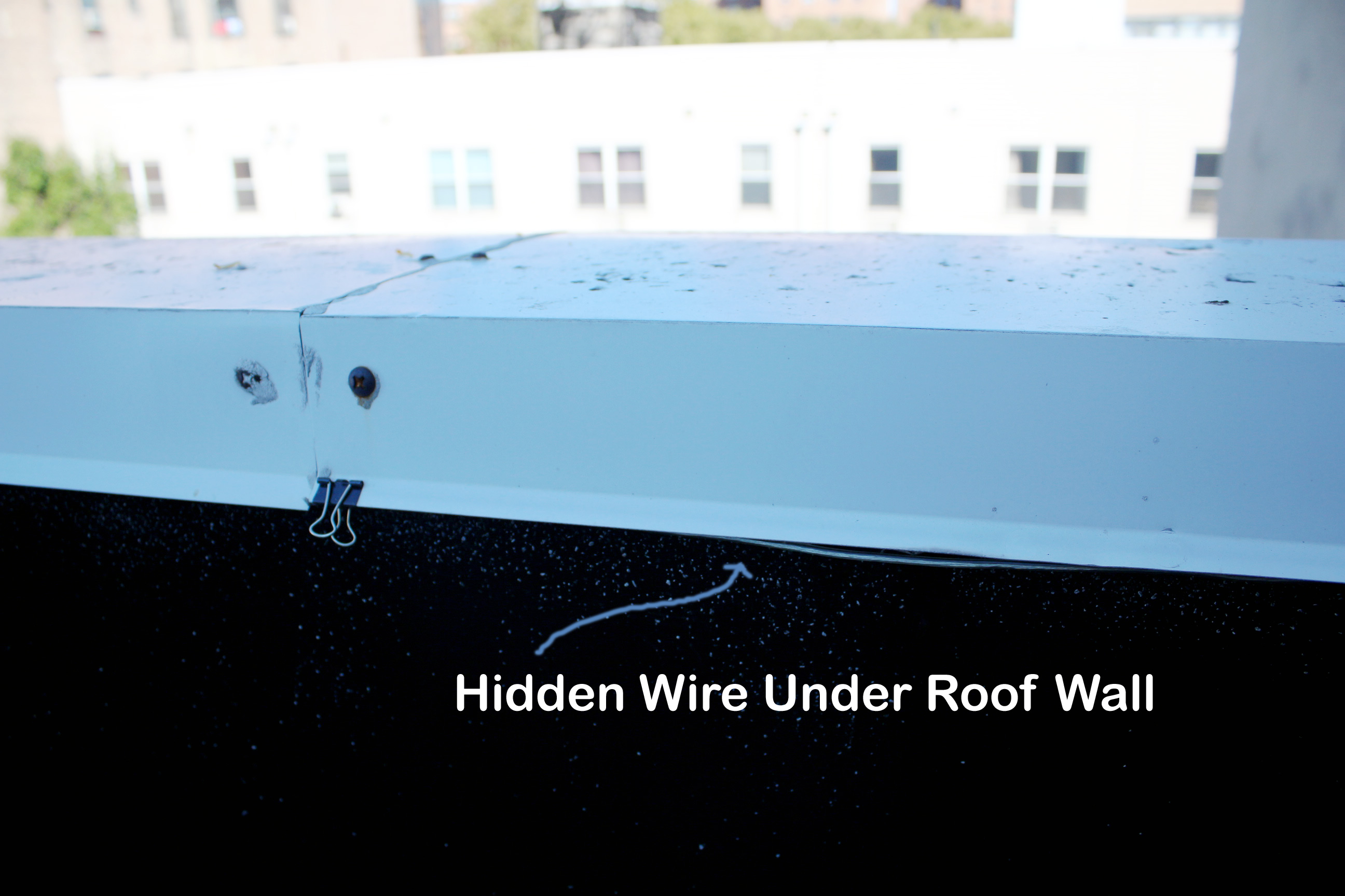 Hidden wire underneath roof wall cover.